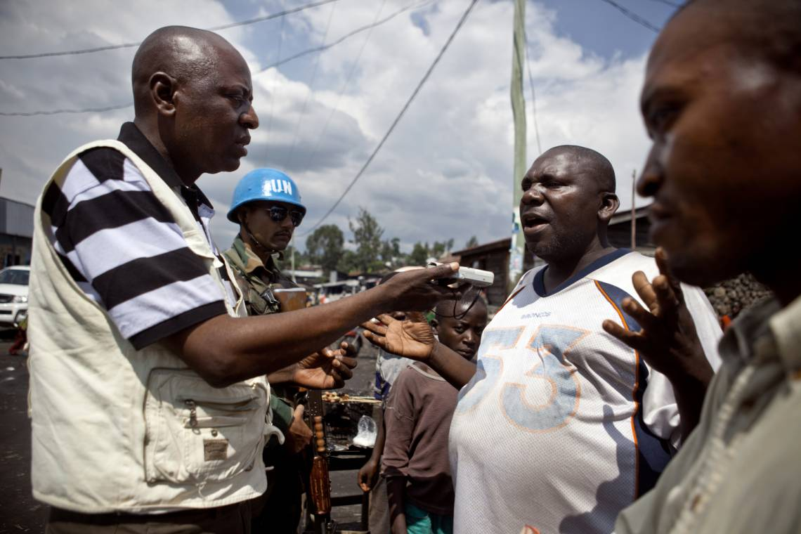 A journalist from Radio Okapi, the UN radio station in the Democratic Republic of Congo, reporting in Masisi, east of the DRC, in November 2011.